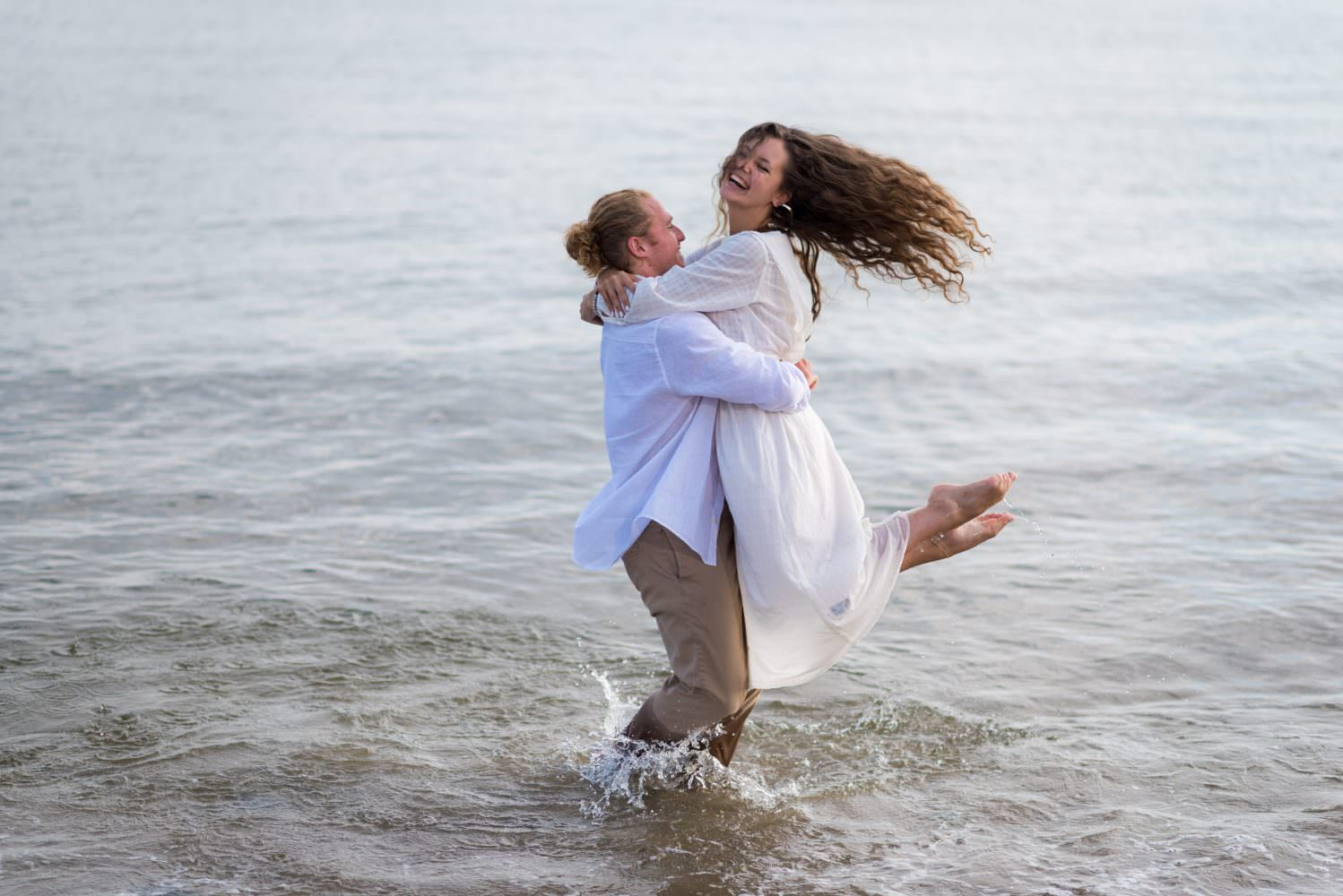 A couple spinning in water